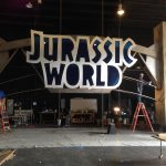 Sign added to the top portion of the Jurassic World Comic Con gates.